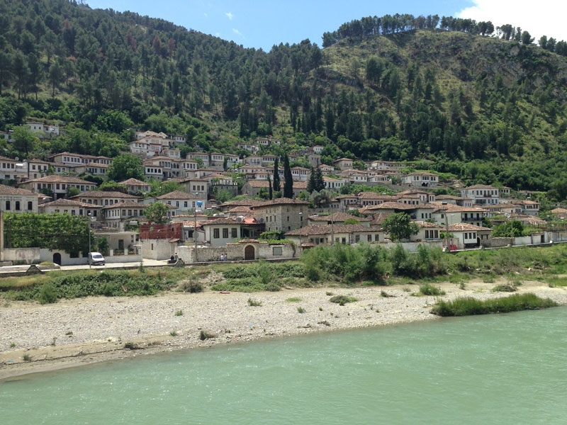In Berat. Houses appear to grow naturally out of the hillside.